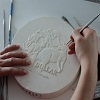 Sculpting a coin plaster